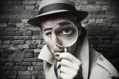 detective-with-magnifying-glass-100735058-large